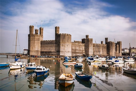 A view of Caernarfon Castle and its surroundings.