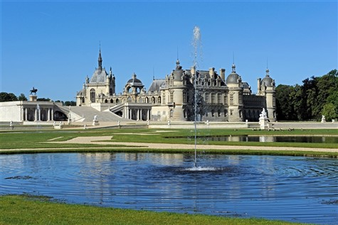 The beautiful Chateau of Chantilly glistening in the sun light.